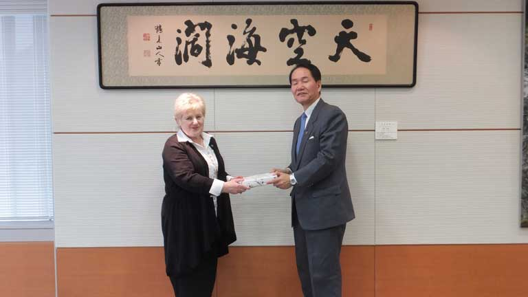 Angela receiving a gift from the Governor of Kagawa