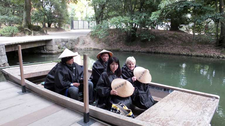 Traditional boat trip round the lake at Ritsurin Gardens